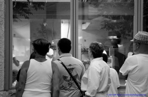 People looking in gallery window by Jeff Taylor www.uncommonphotography.net